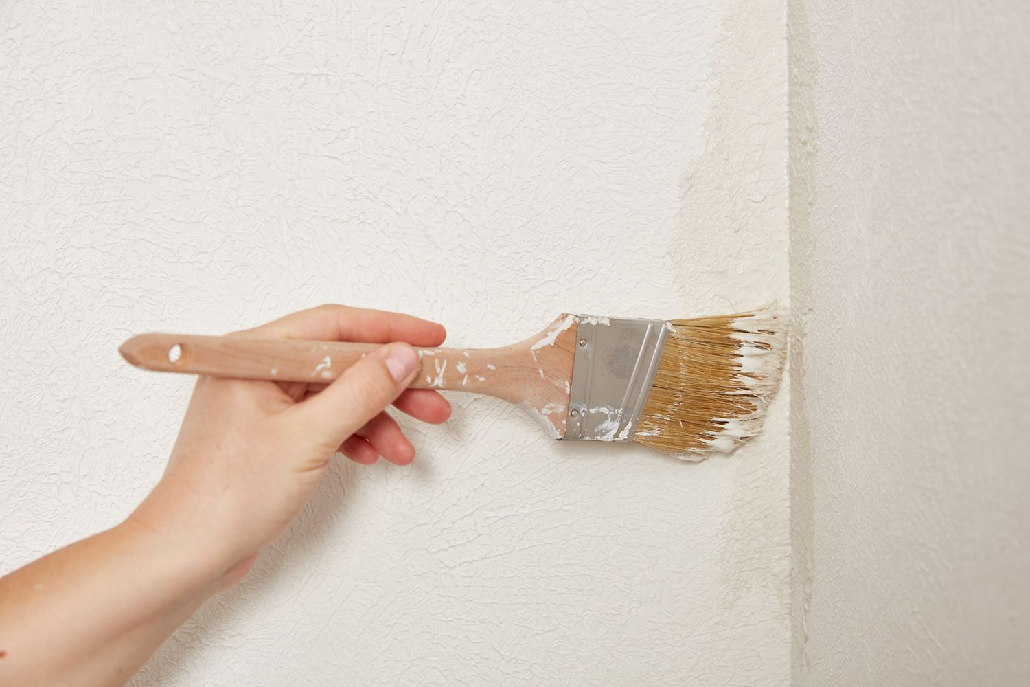 Use flat edge of paintbrush for tight areas