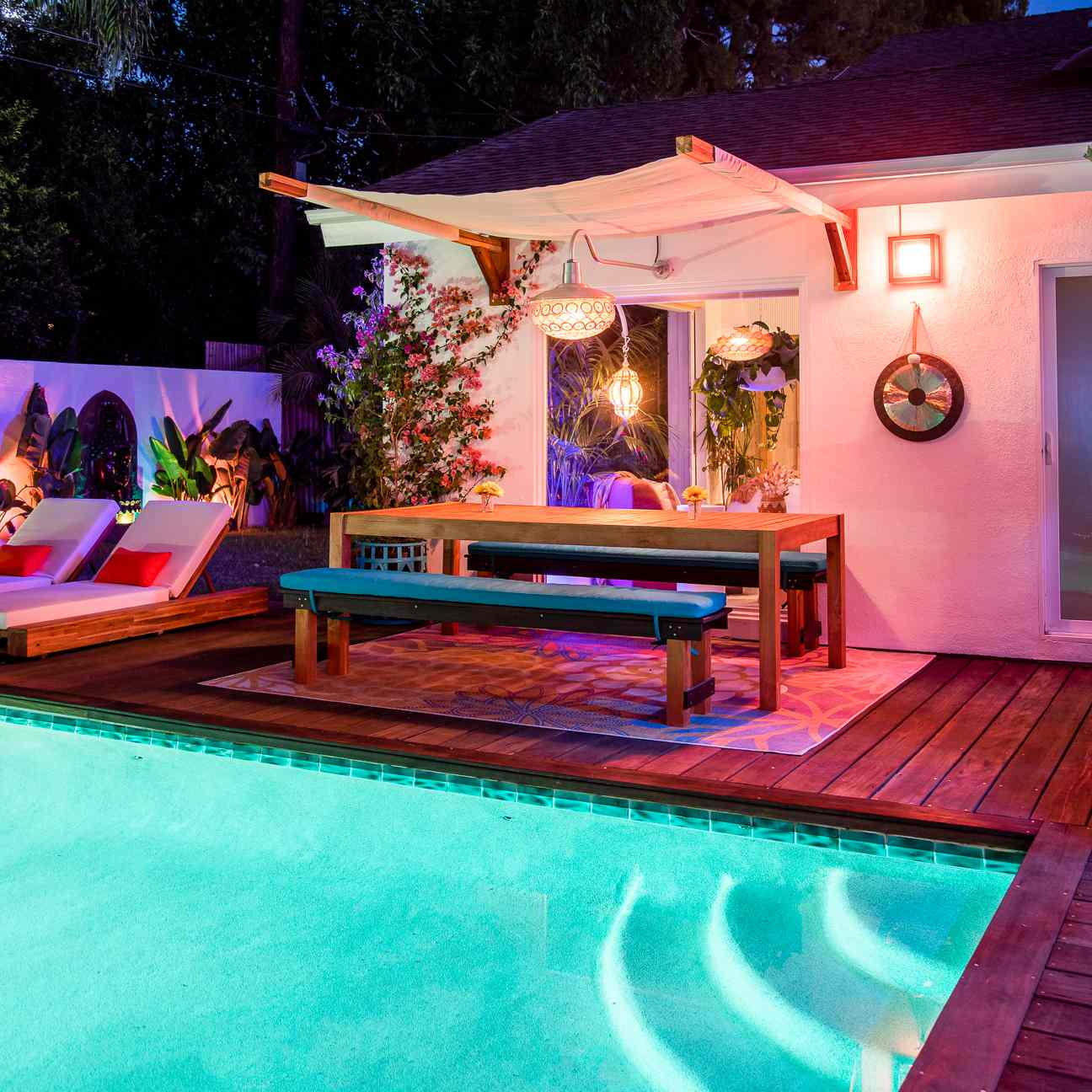 Nightime shot of pool and outdoor dining area