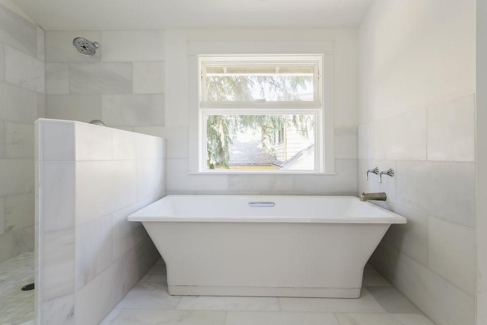 Bathtub and shower in modern bathroom