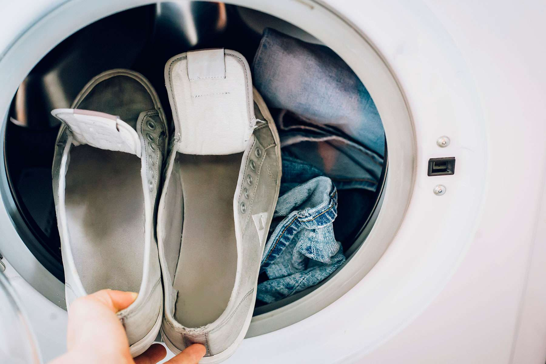 placing shoes in the washer