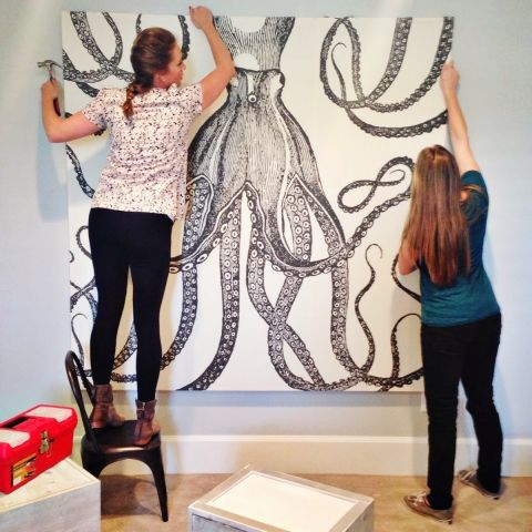 Women hanging squid wall art