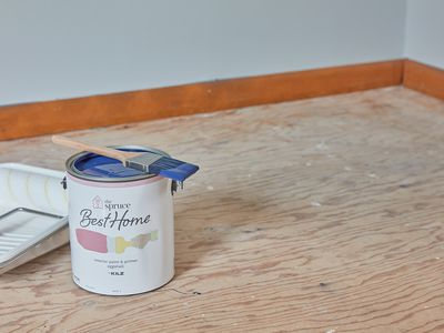 Can of paint on unfinished floor