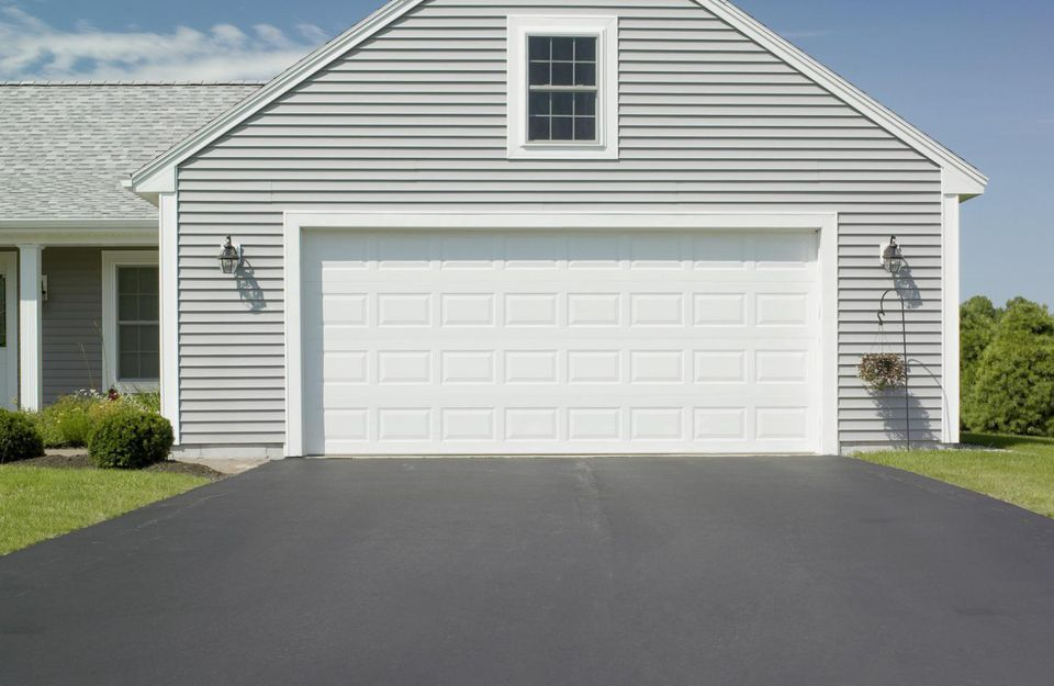 An asphalt driveway and a house's garage