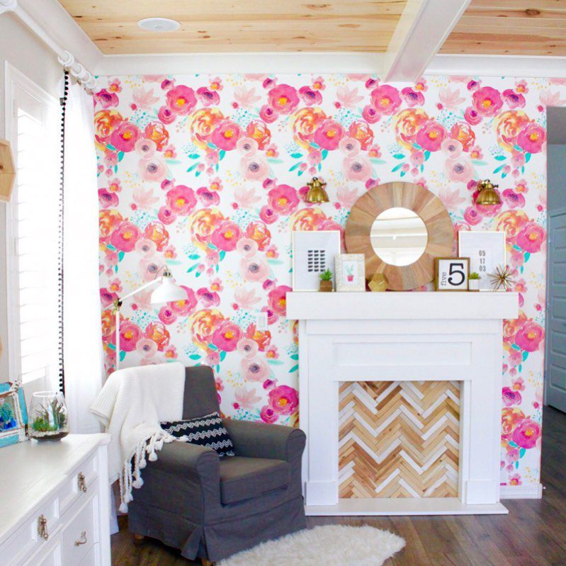 Colorful wallpaper and a faux fireplace