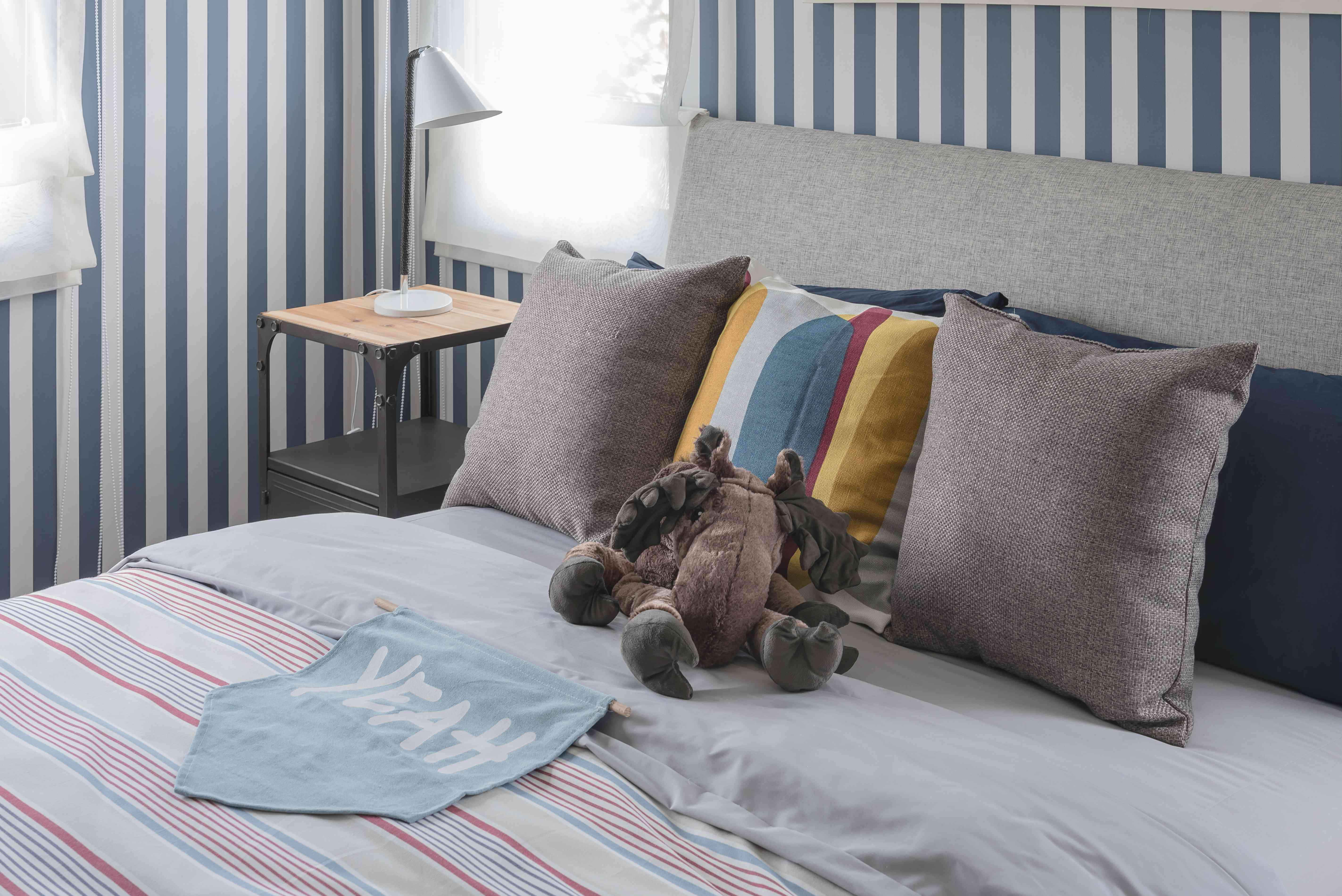 kid's bedroom with doll on bed