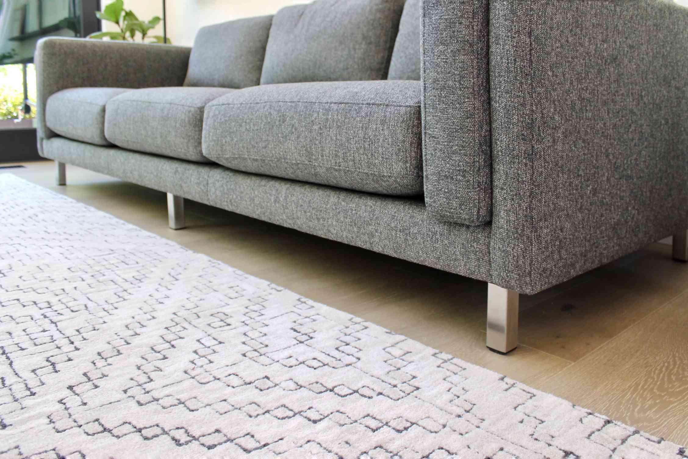area rug near a sofa