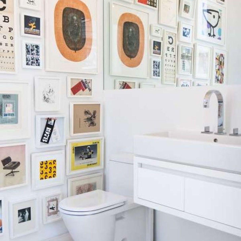 wall art in a white bathroom