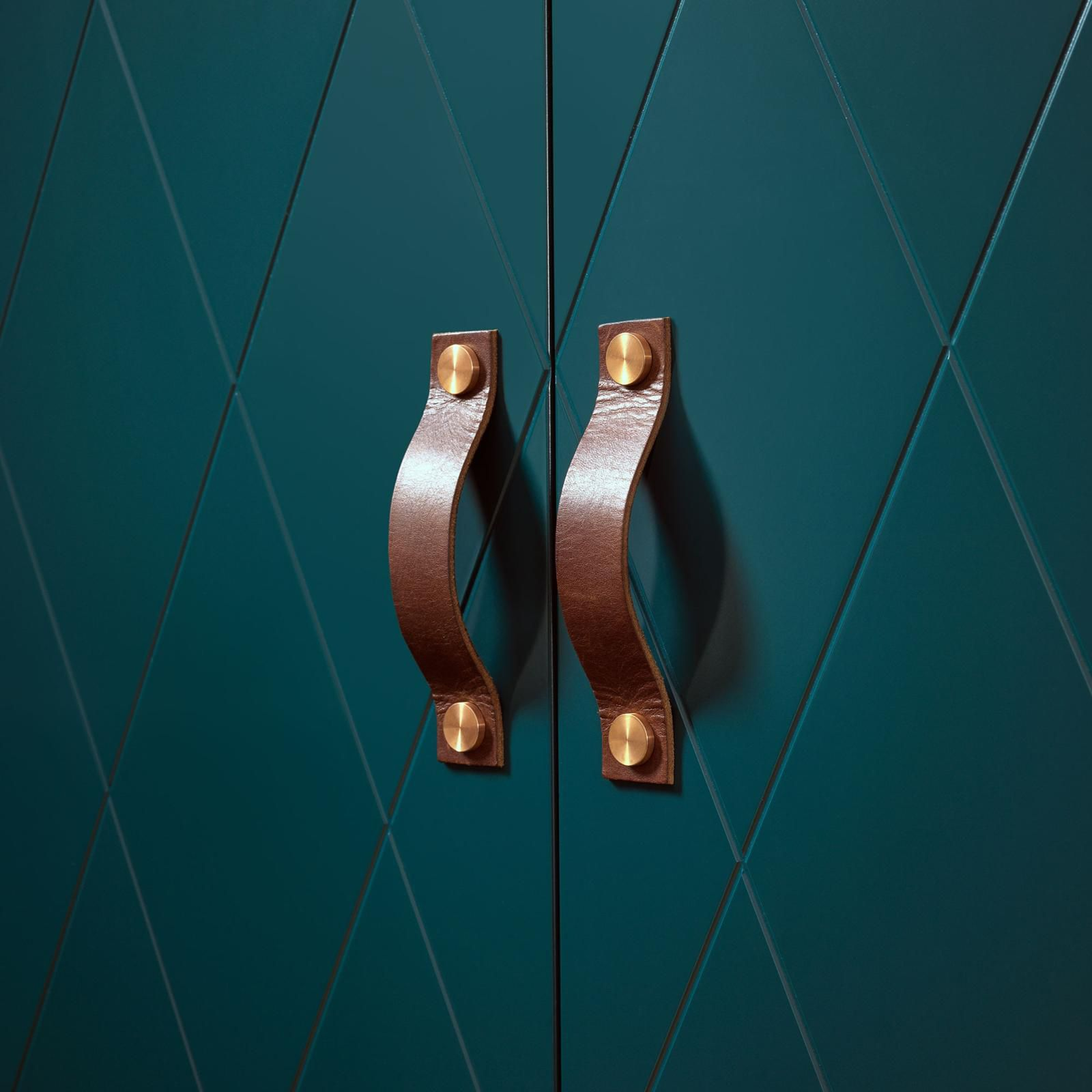 Teal cabinet doors with brown leather pulls