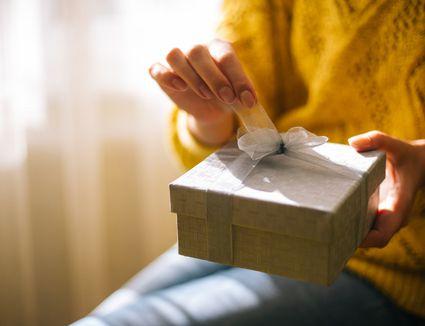 Teenager opening gift