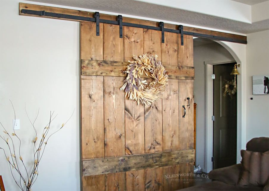 A large barn door with a wreath on it