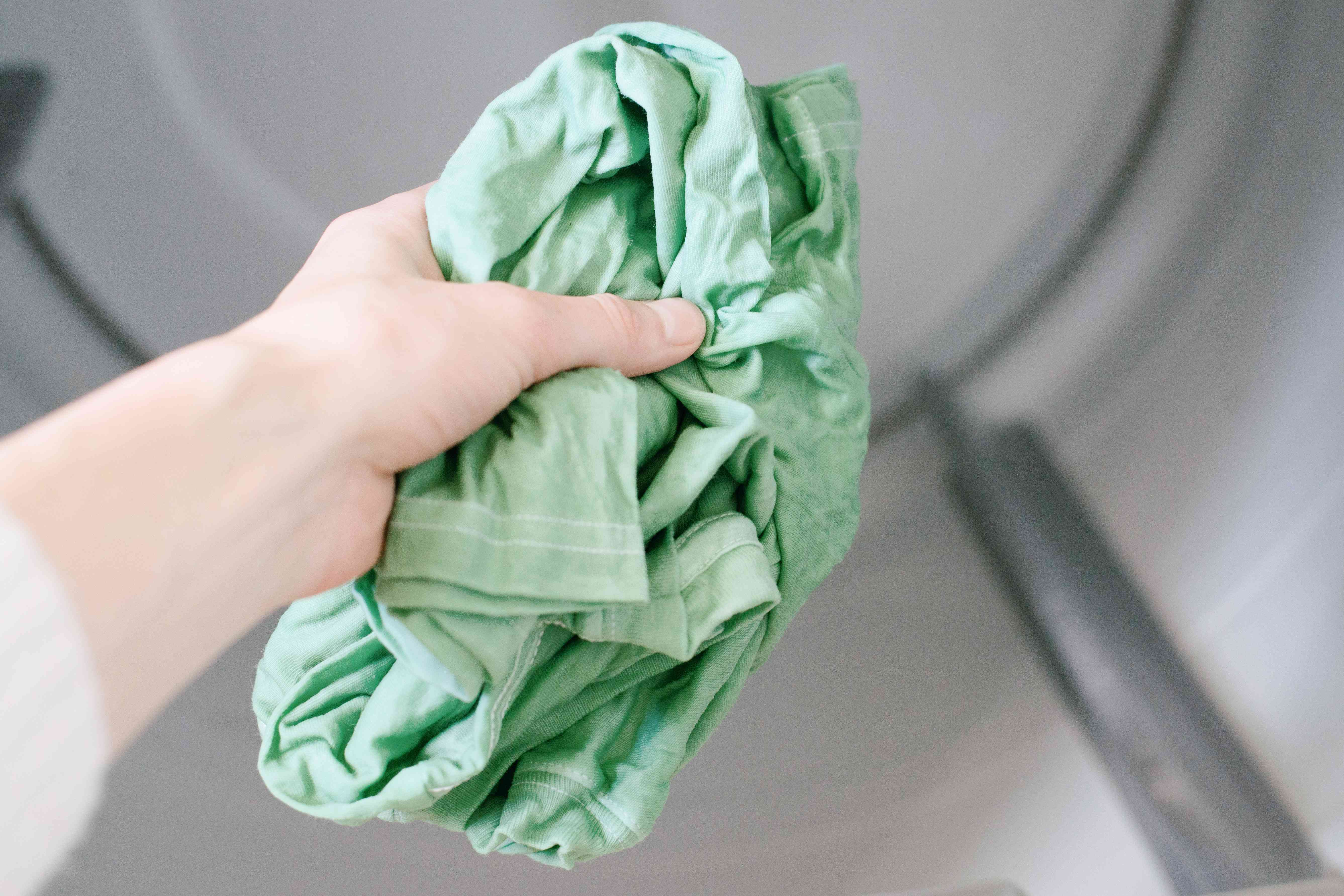 adding dyed clothing to the dryer