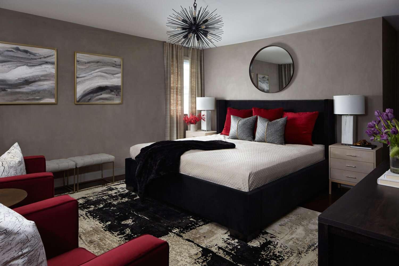 bedroom with neutral color scheme, pops of red, starburst chandelier