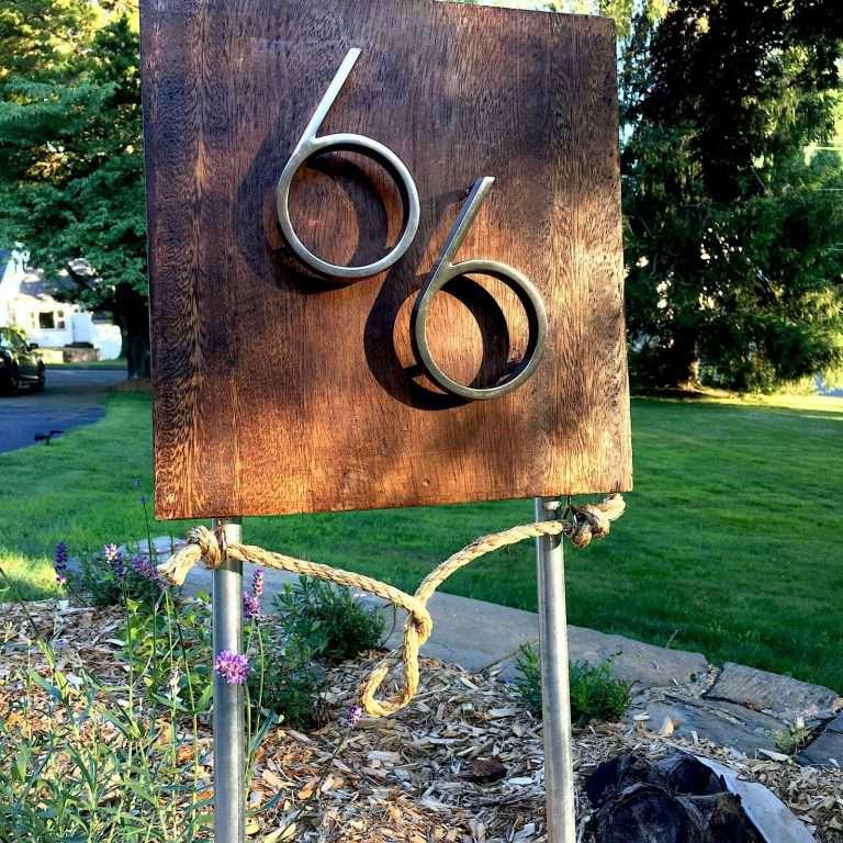 A modern-looking address sign.