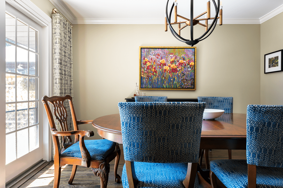 chippendale chair in formal dining room with artwork