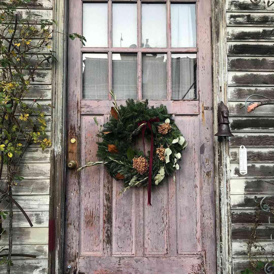 Rustic door with simple wreath
