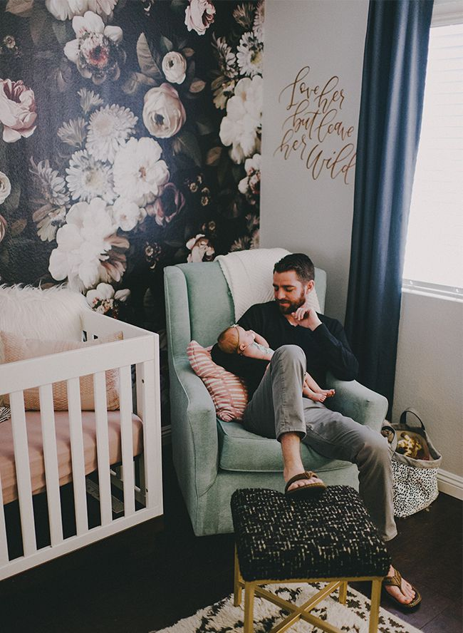 Black and white nursery with moody floral accent wall