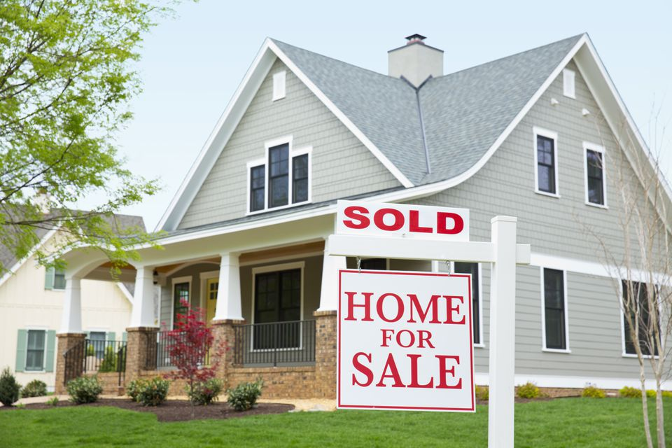 House with ''sold'' sign in front yard