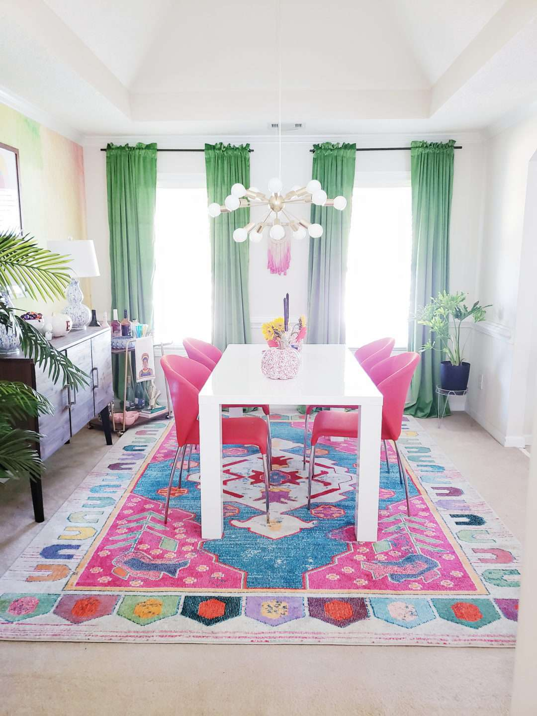 pink and green dining room with curtains