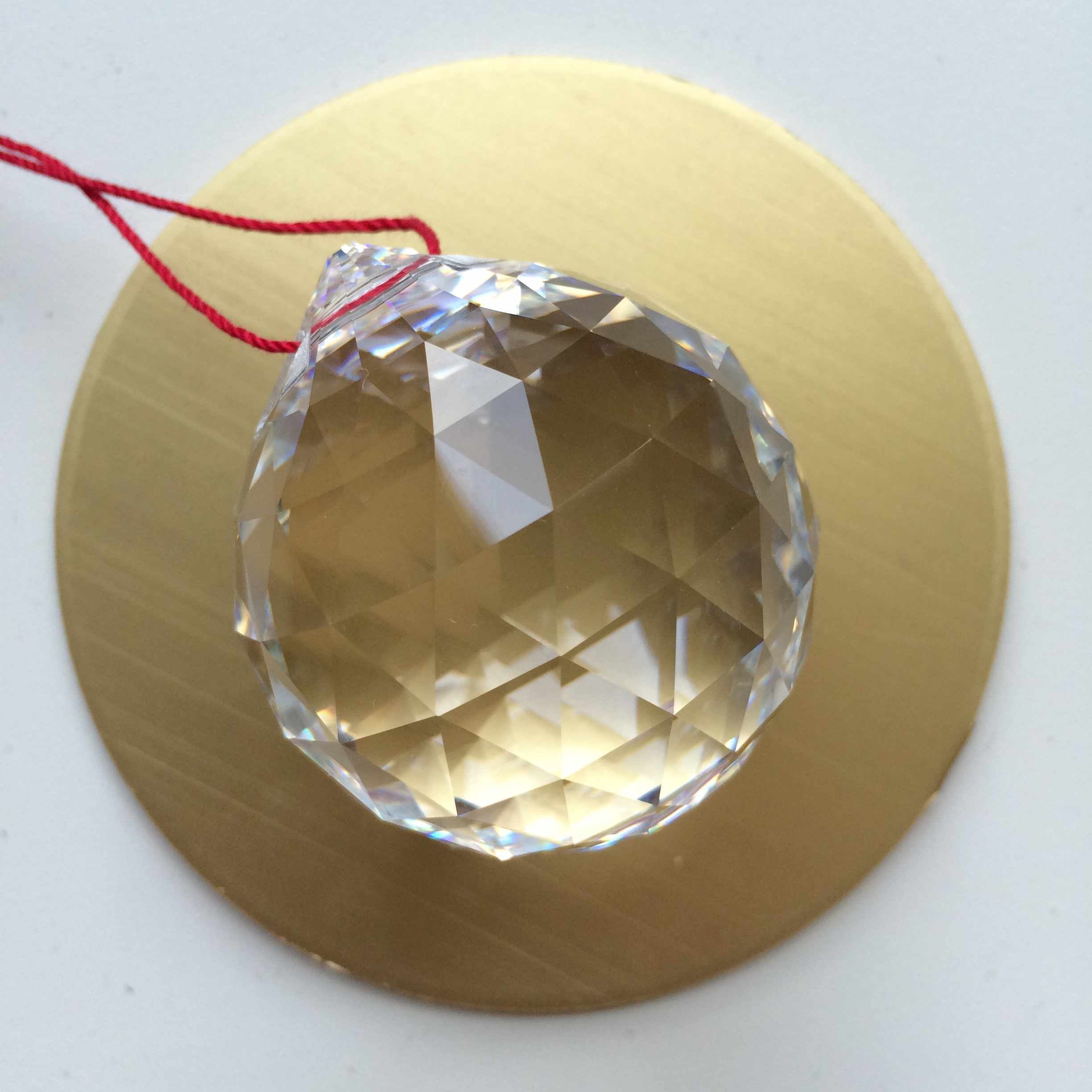 feng shui crystal ball on a red string