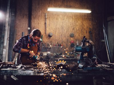 man working in workshop with power tools