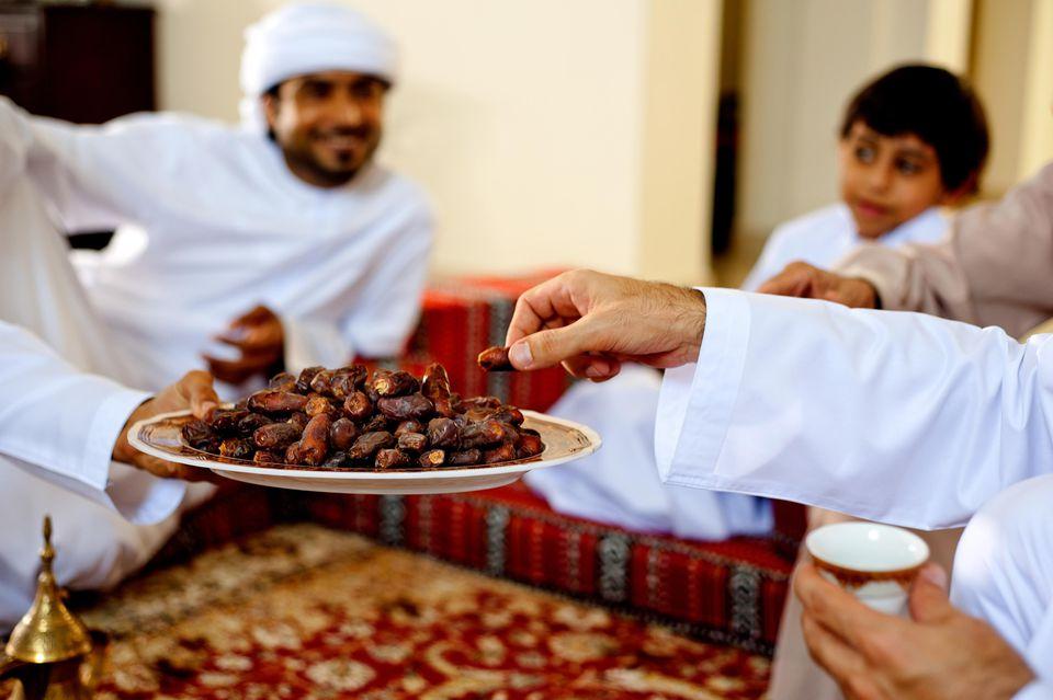 Middle Eastern Culture Men sit together.