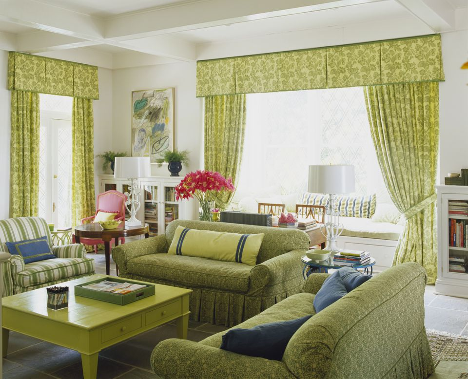 Bright green fabrics in a living room with window seat