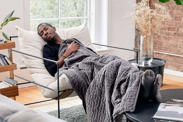 man napping with weighted blanket