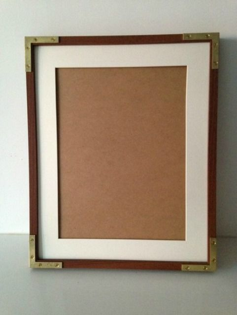 Picture frame with hardware corners