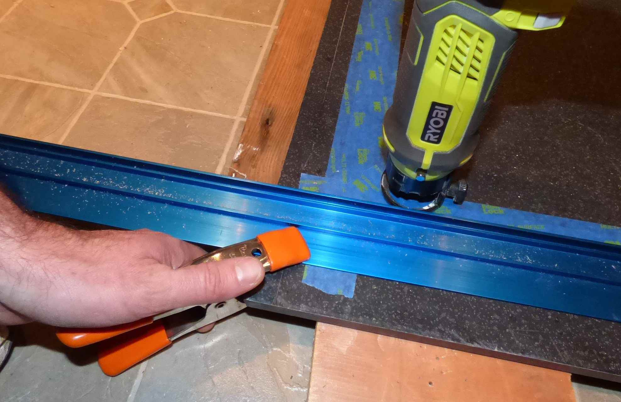 Set Guide Track In Place With Clamps