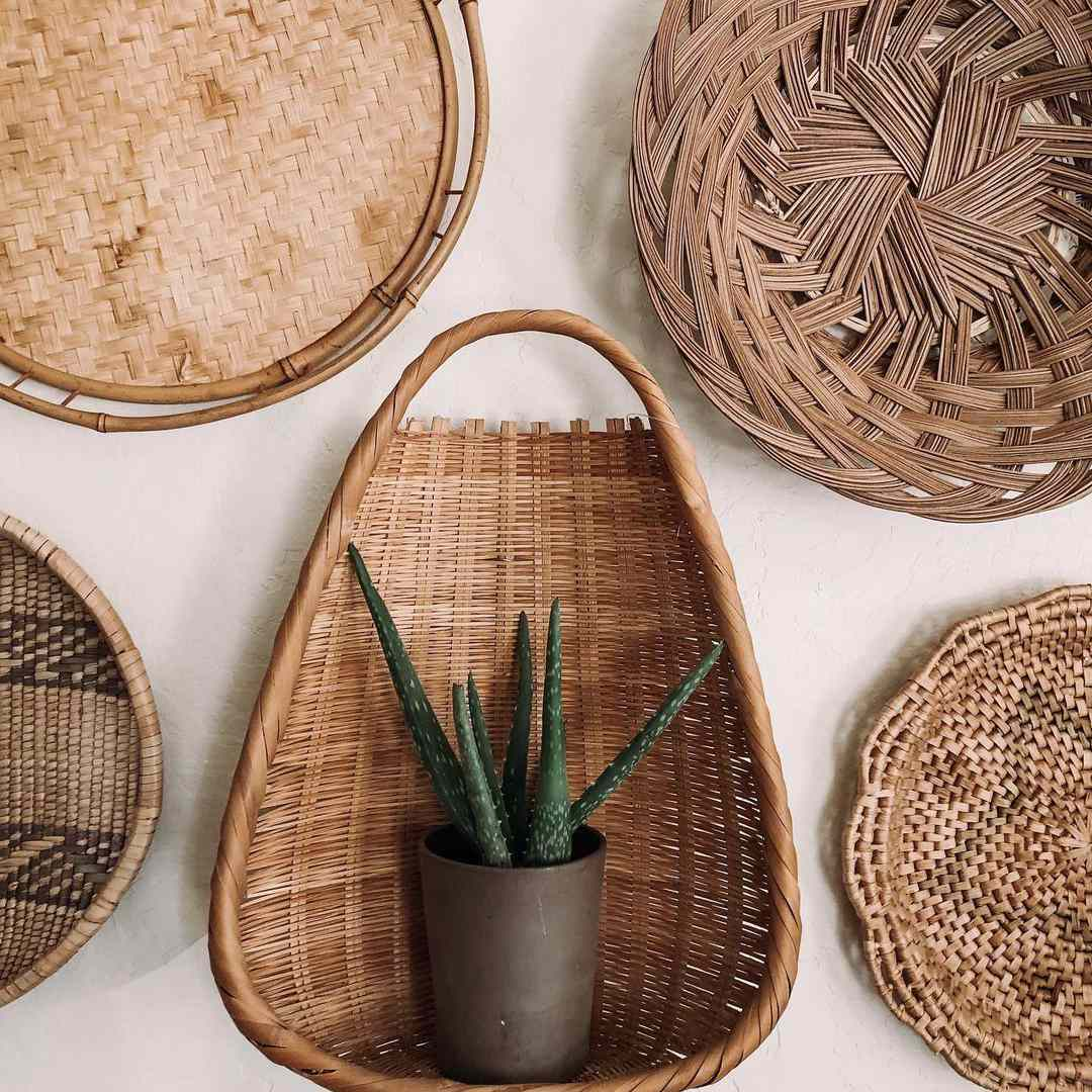 Baskets on a wall with a planter