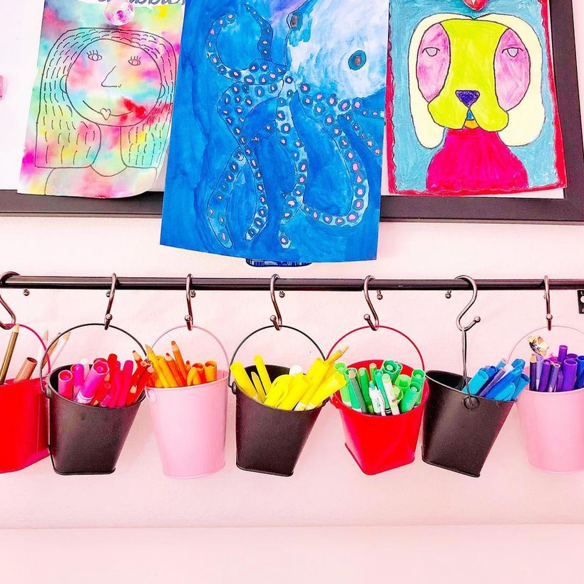small hanging baskets on rod for storing smaller art supplies