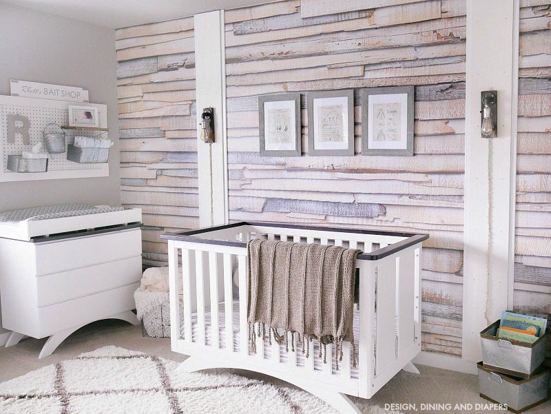 rustic nursery with wood print wallpaper accent wall