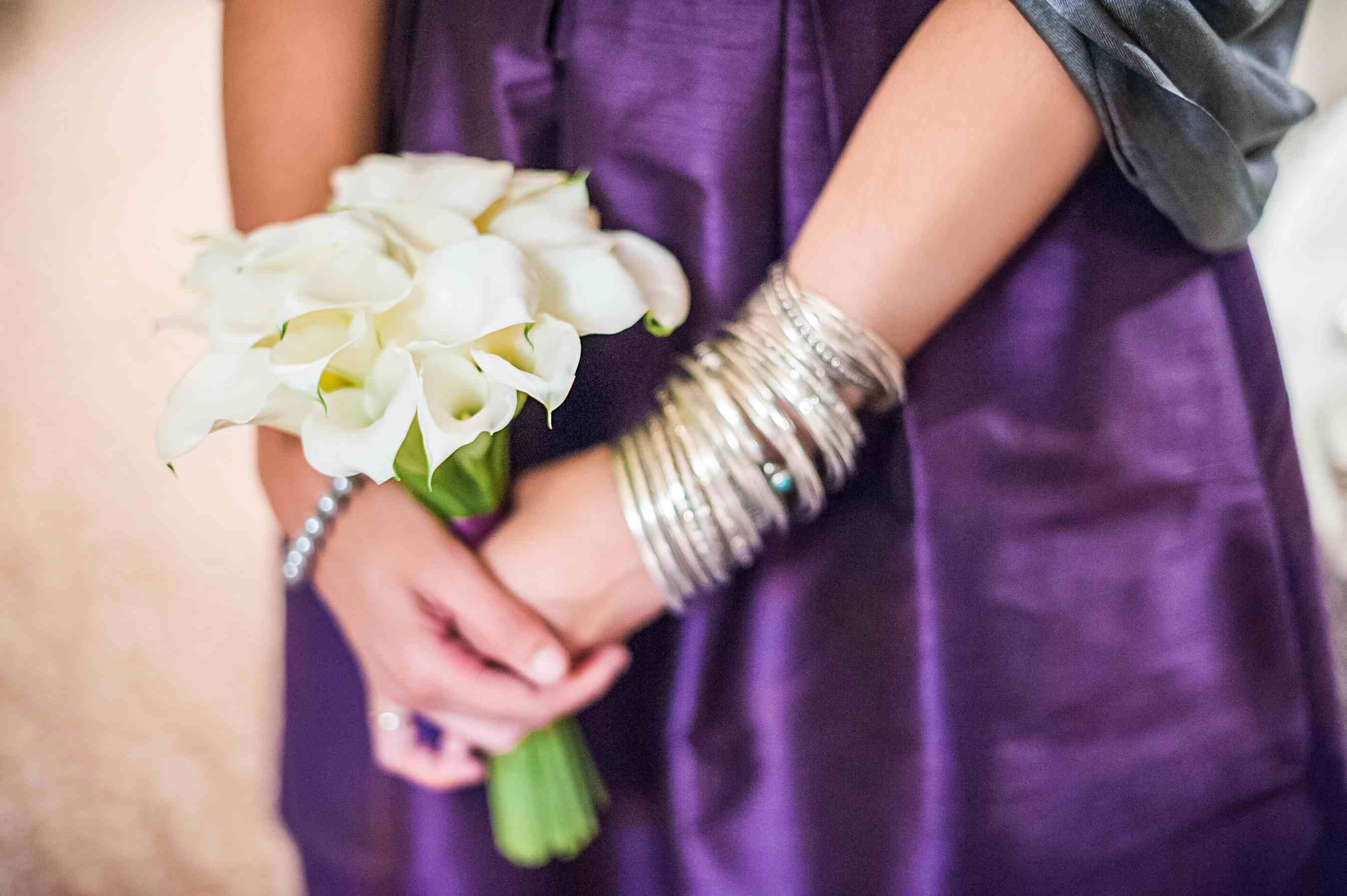 Bridesmaid bouquet made up of white calla lilies