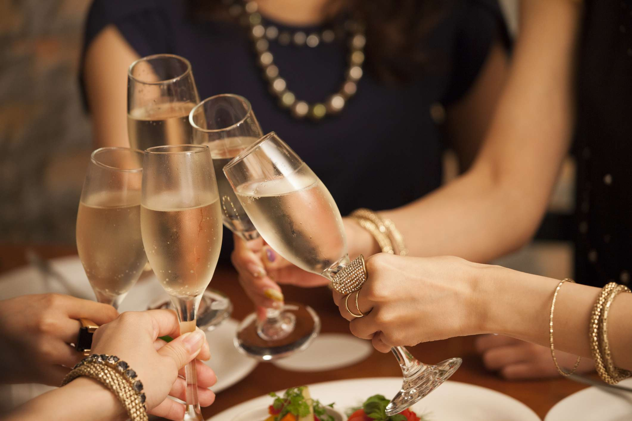 Friends clinking champagne glasses at birthday party