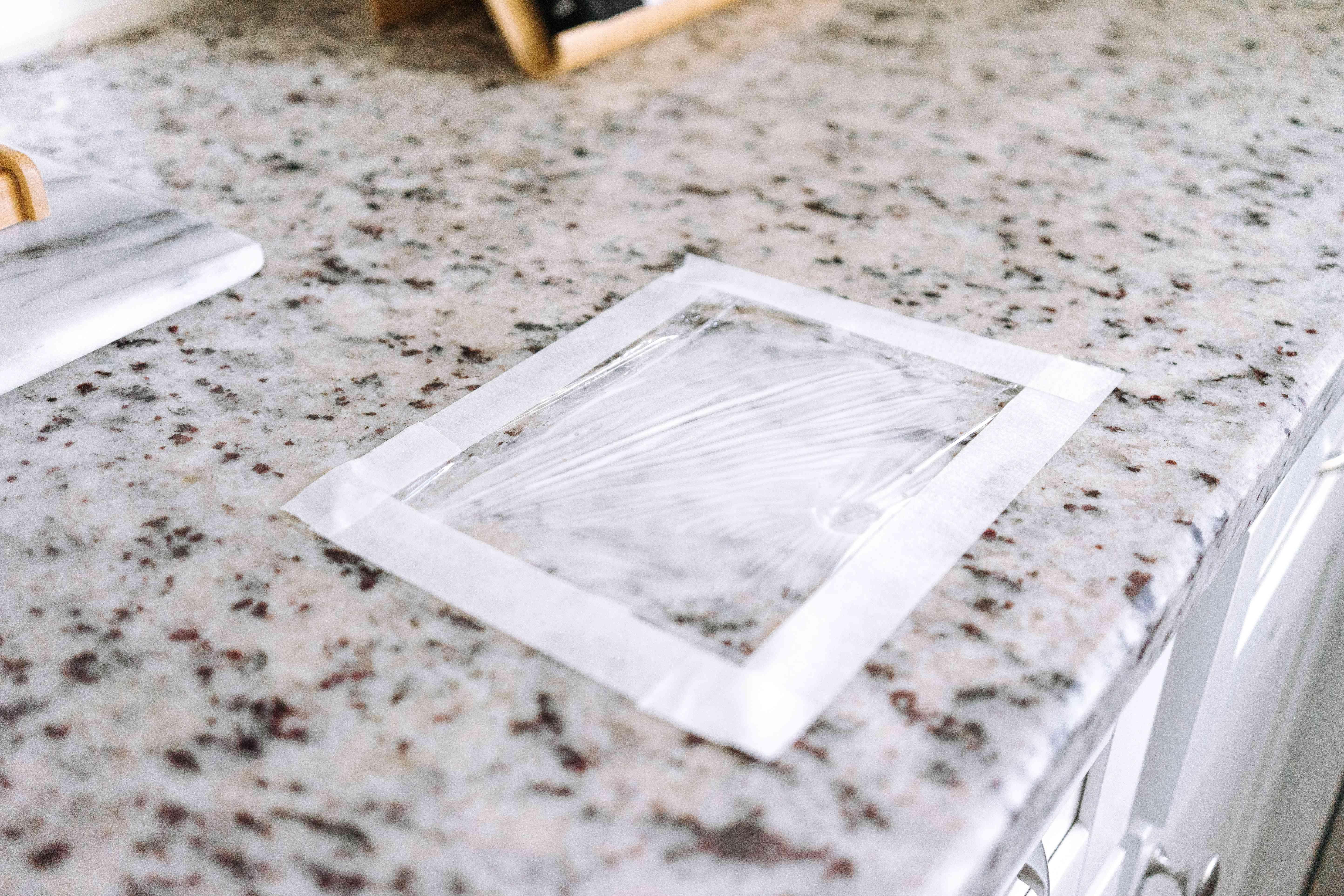 plastic wrap on a granite countertop