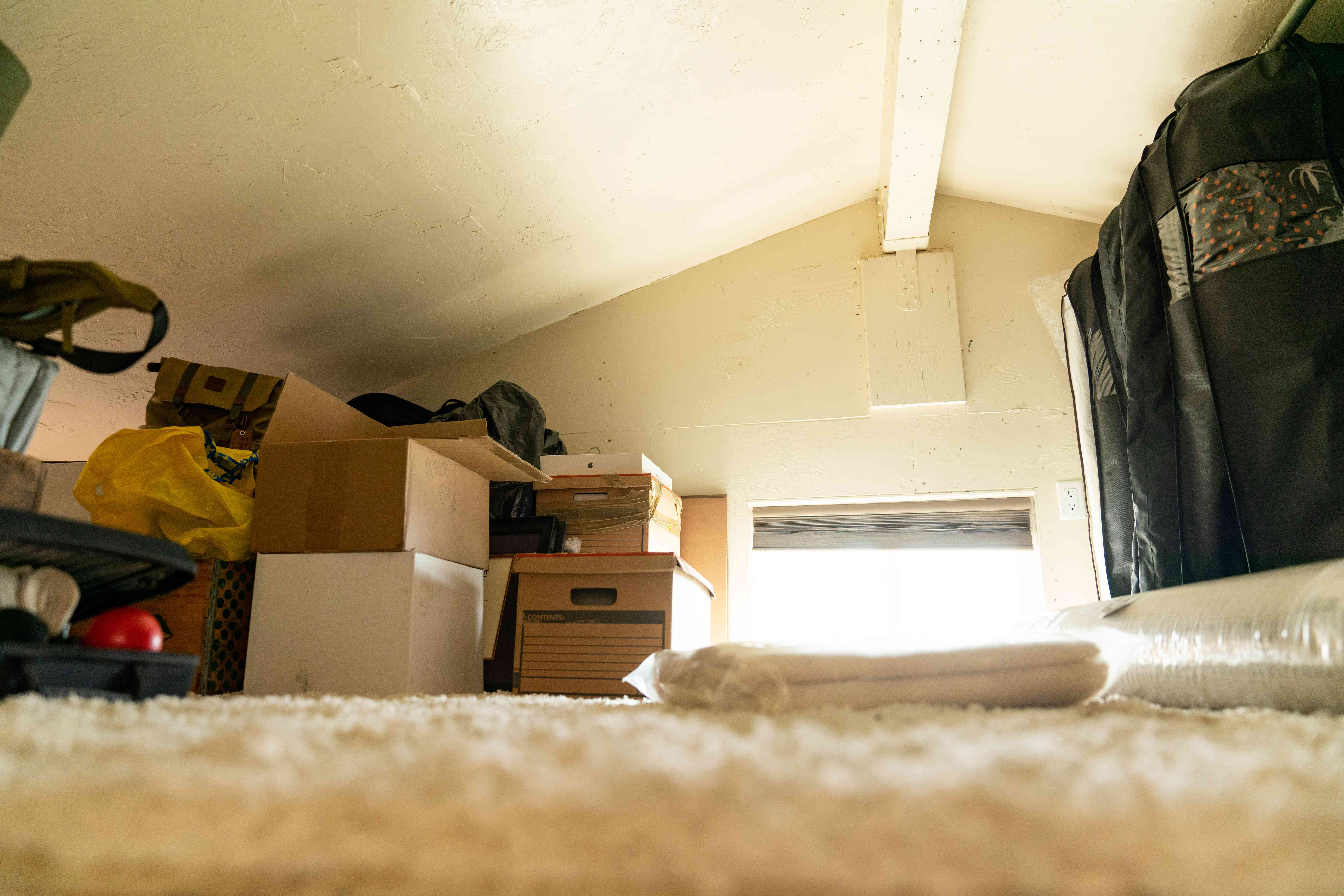 Attic crawl space with boxes causing musty odor