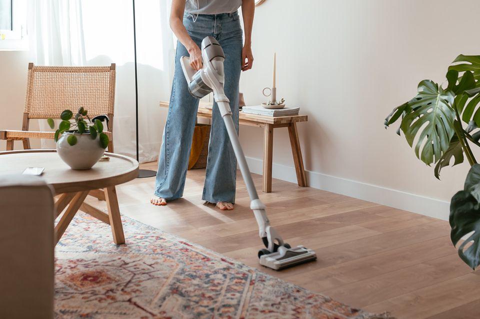 woman vacuuming the floor