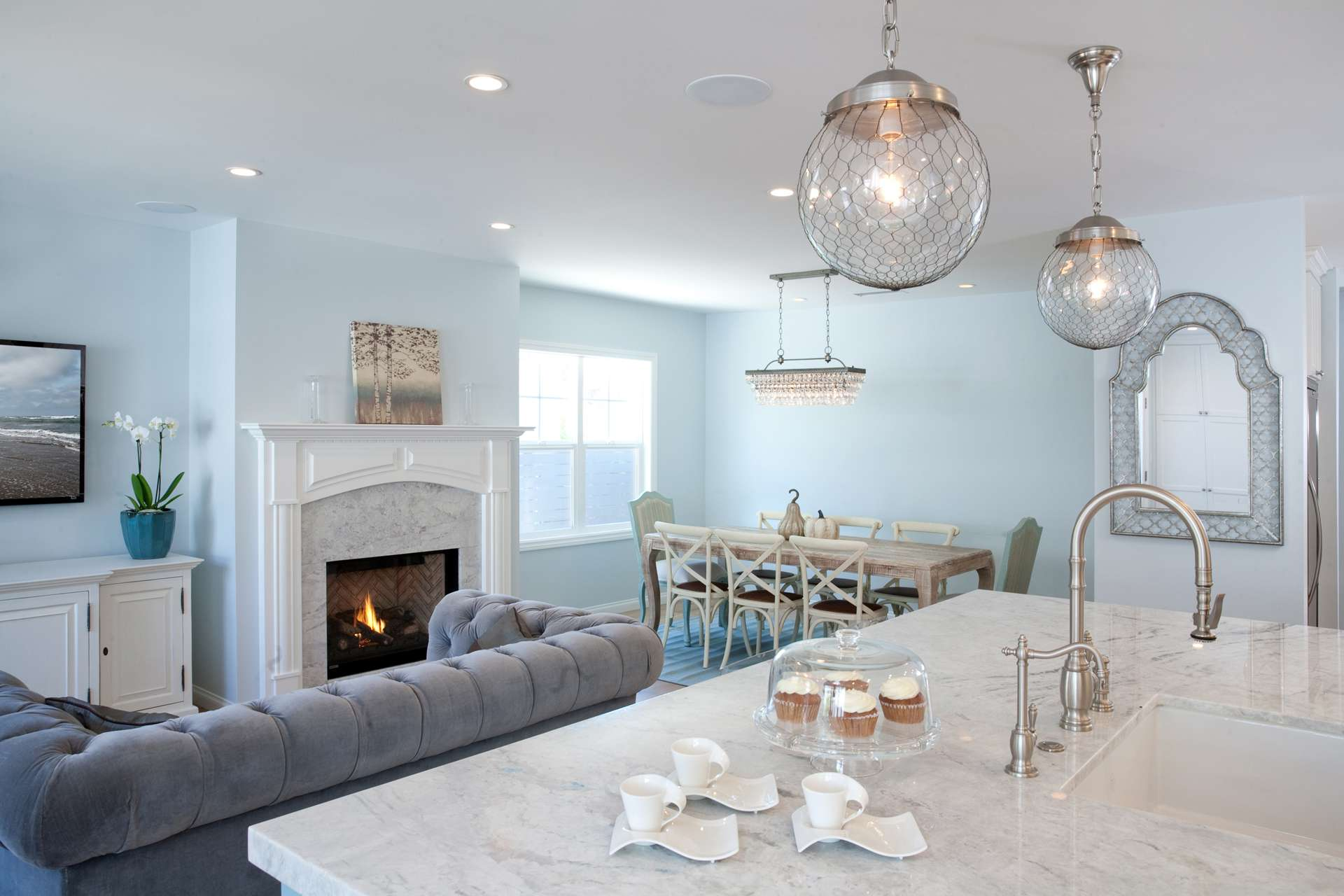 Marble fireplace matches kitchen counter top