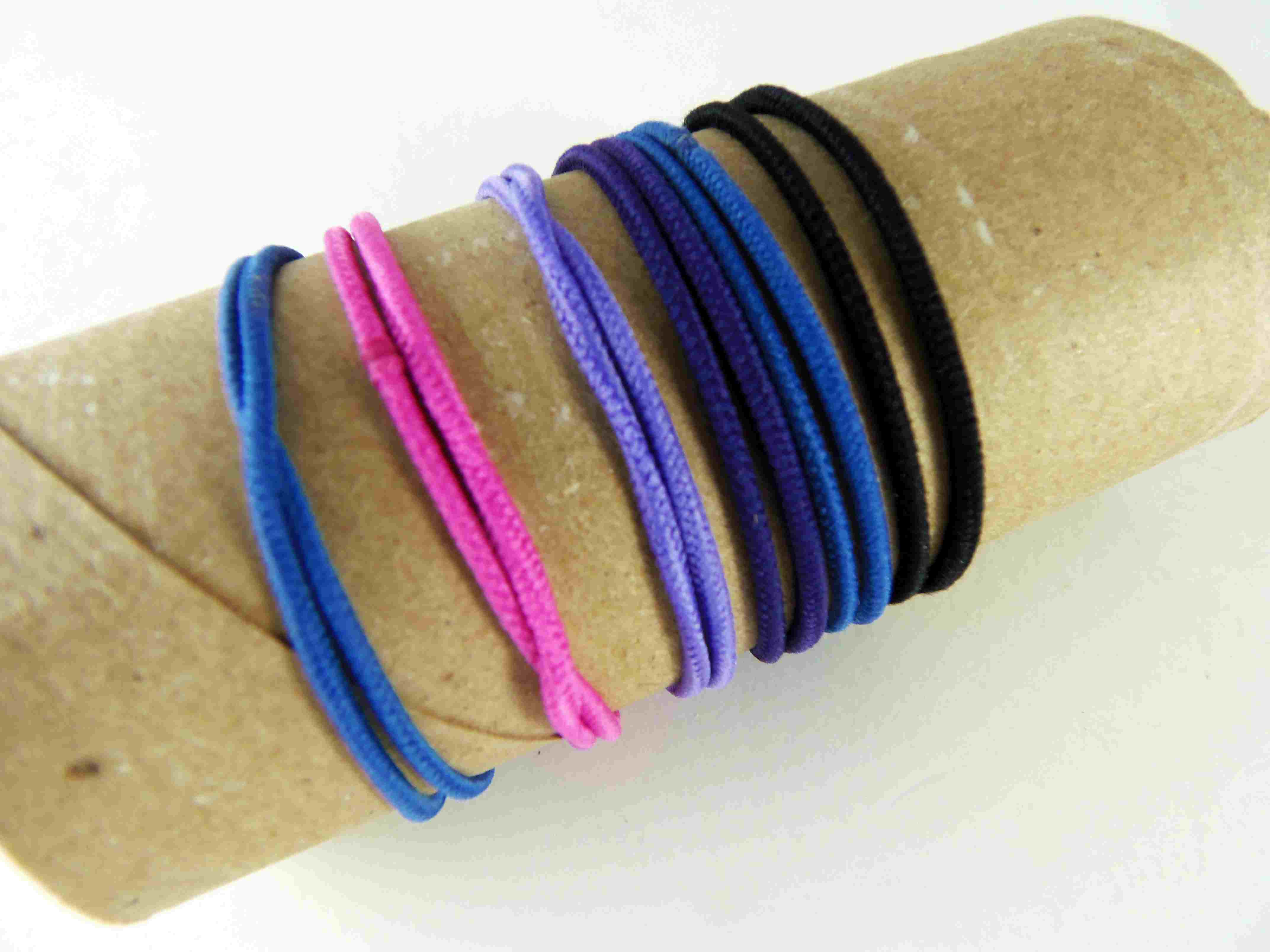 Hair bands on a toilet roll