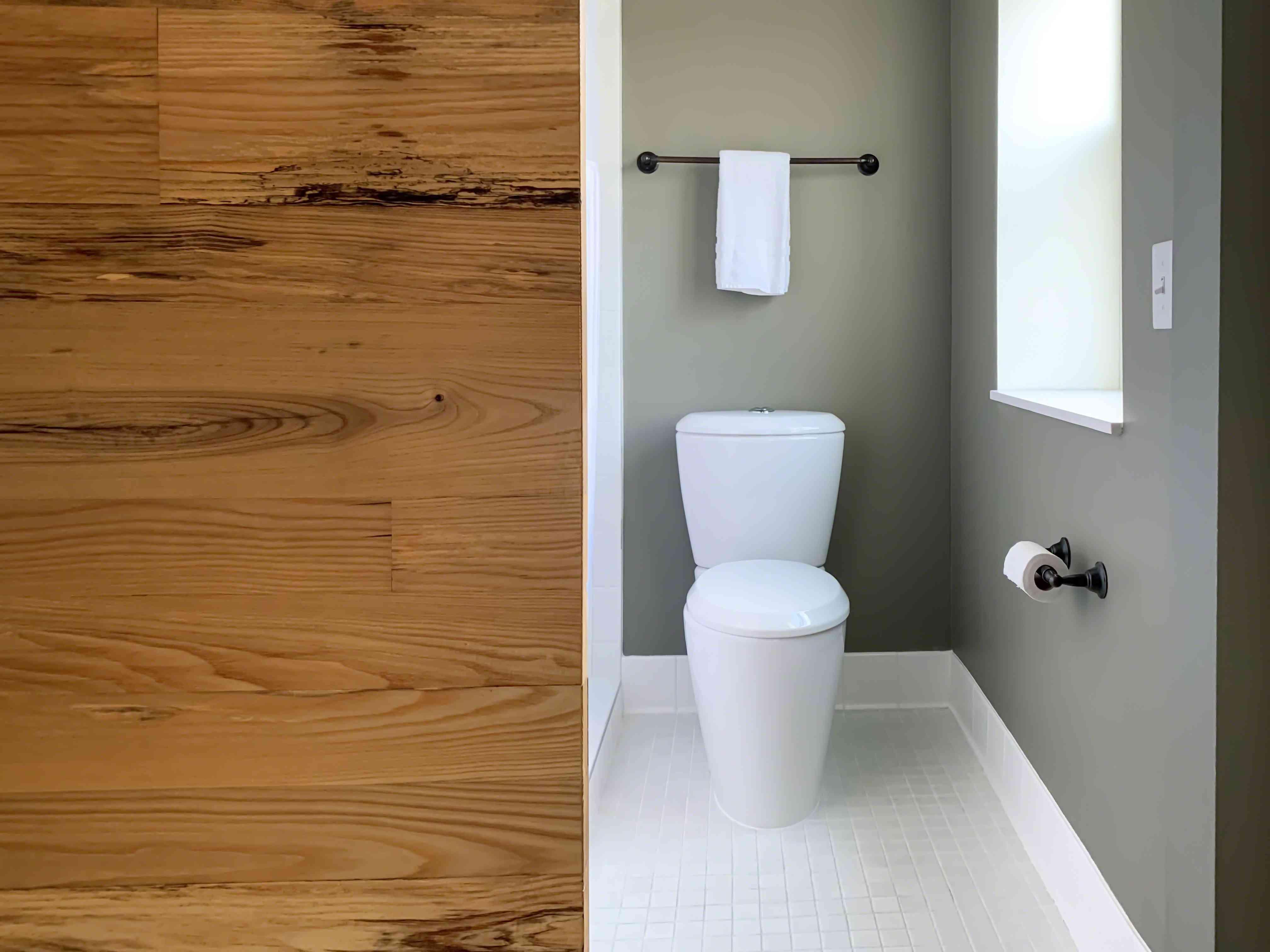Modern bathroom minimal design with barn door