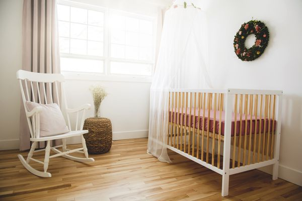 Shot of a modern baby room with crib