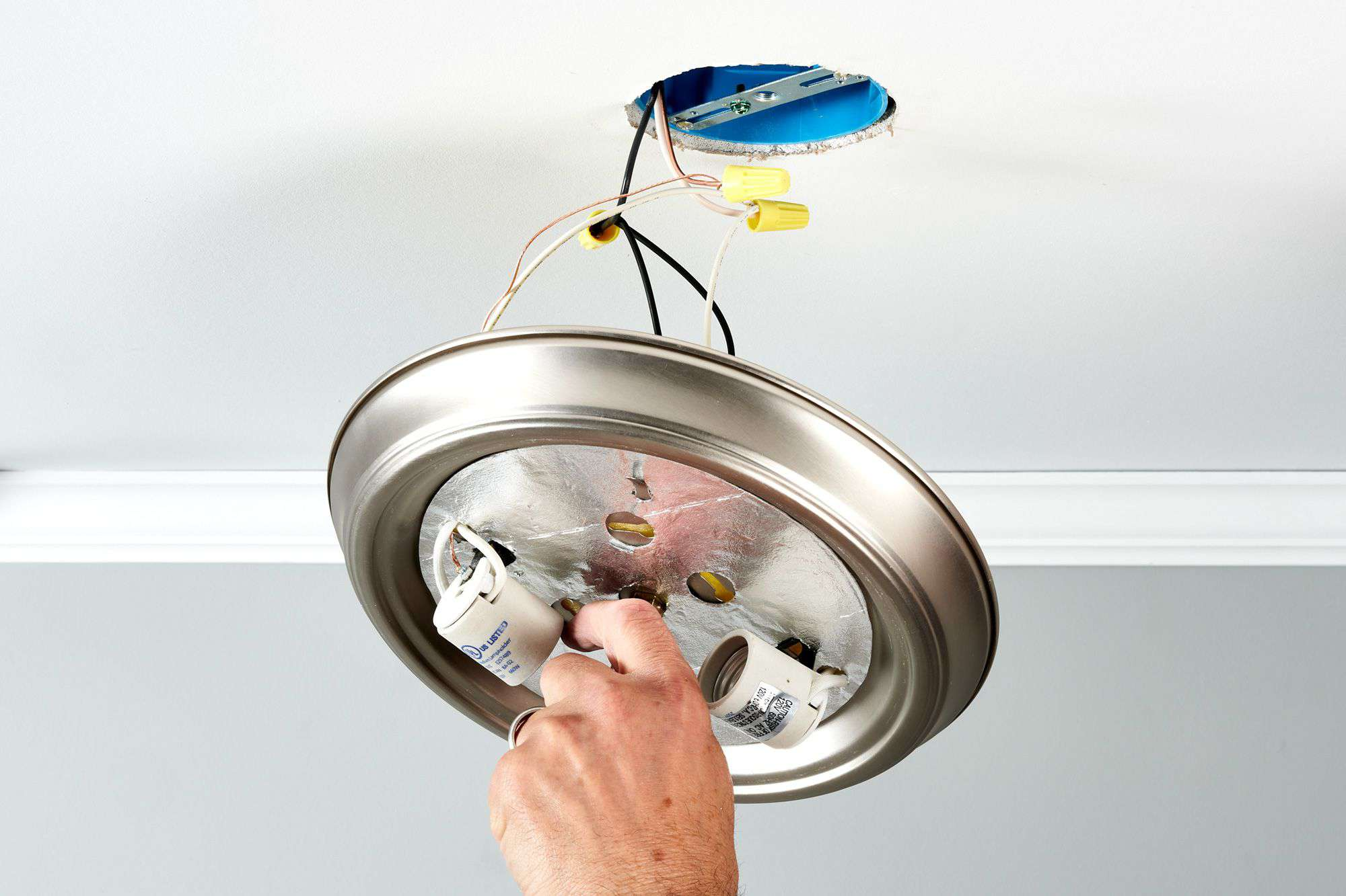 Removing a light fixture from the ceiling