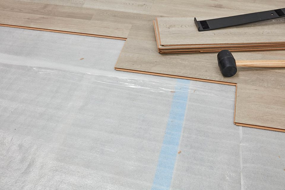 Underlayment exposed with planks being installed