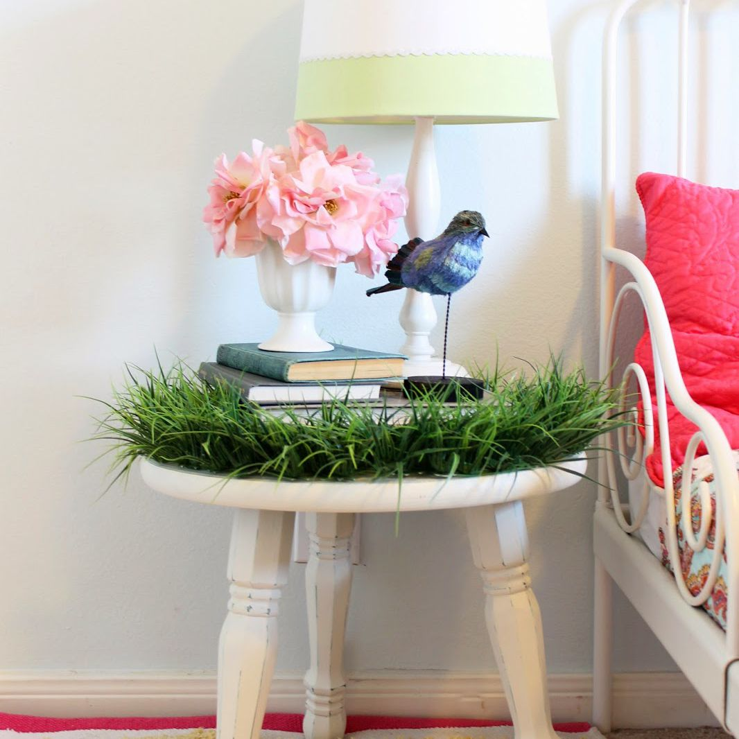 DIY grass-covered nightstand for woodland-themed nursery or kids room