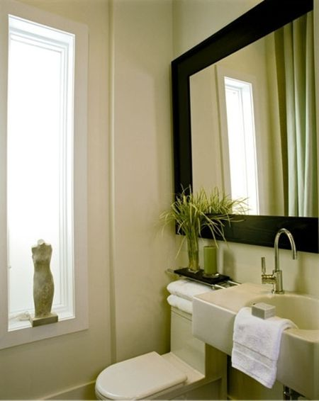 Clean Bathroom With Large Framed Mirror