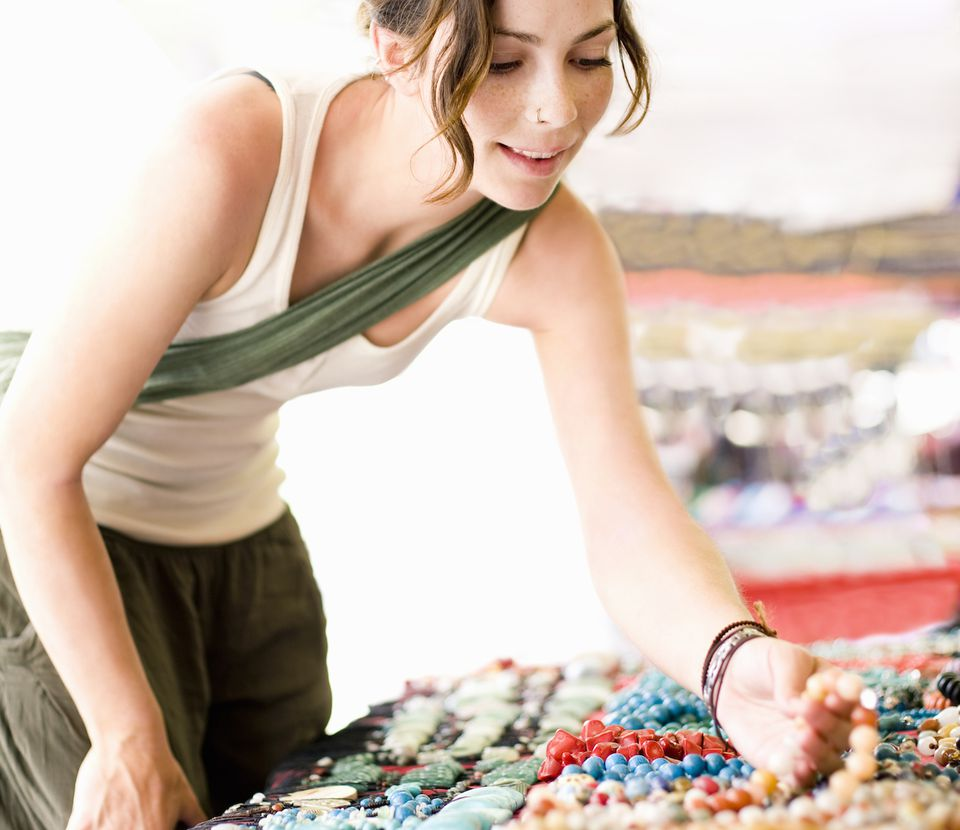 A woman looking at lucky birthstones