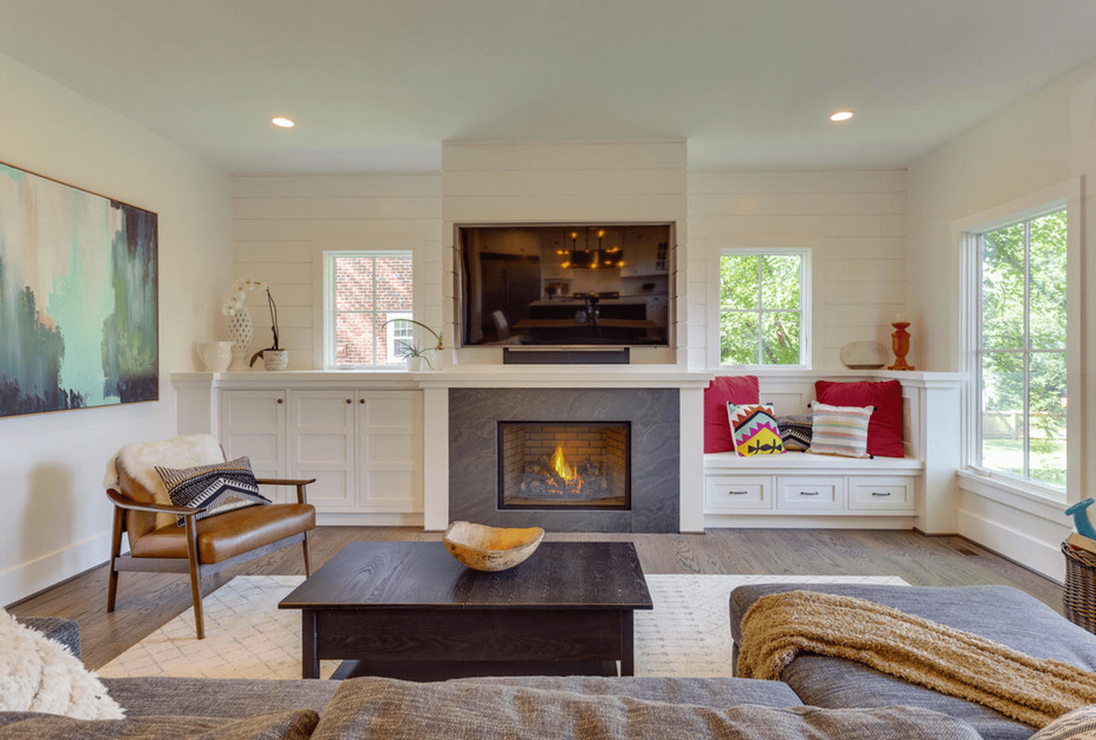 Luxury Fireplace with Cabinets On Either Side