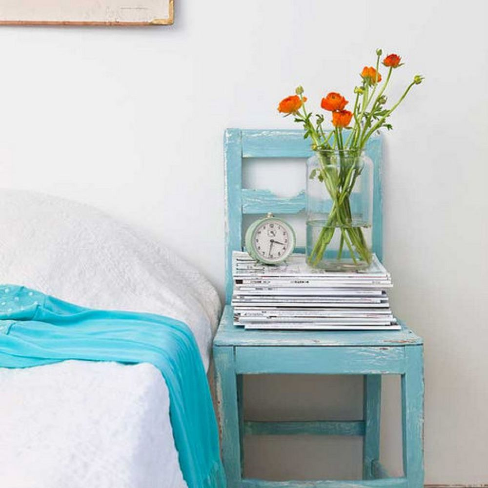 Turquoise chair as nightstand