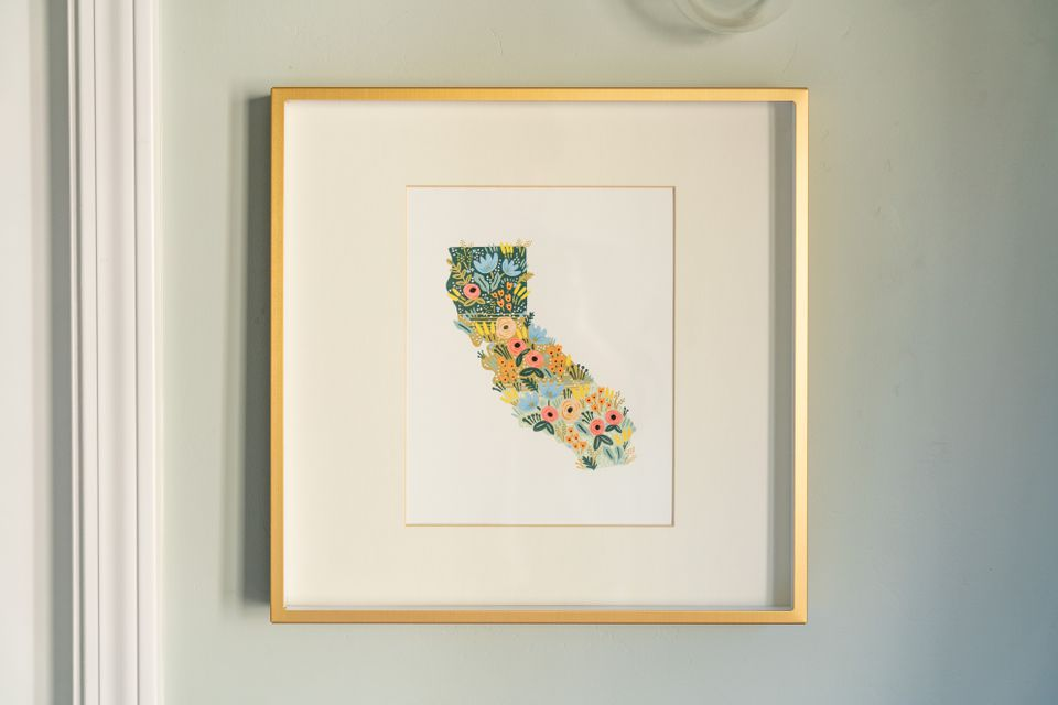 Wall art of california with flowers in gold frame