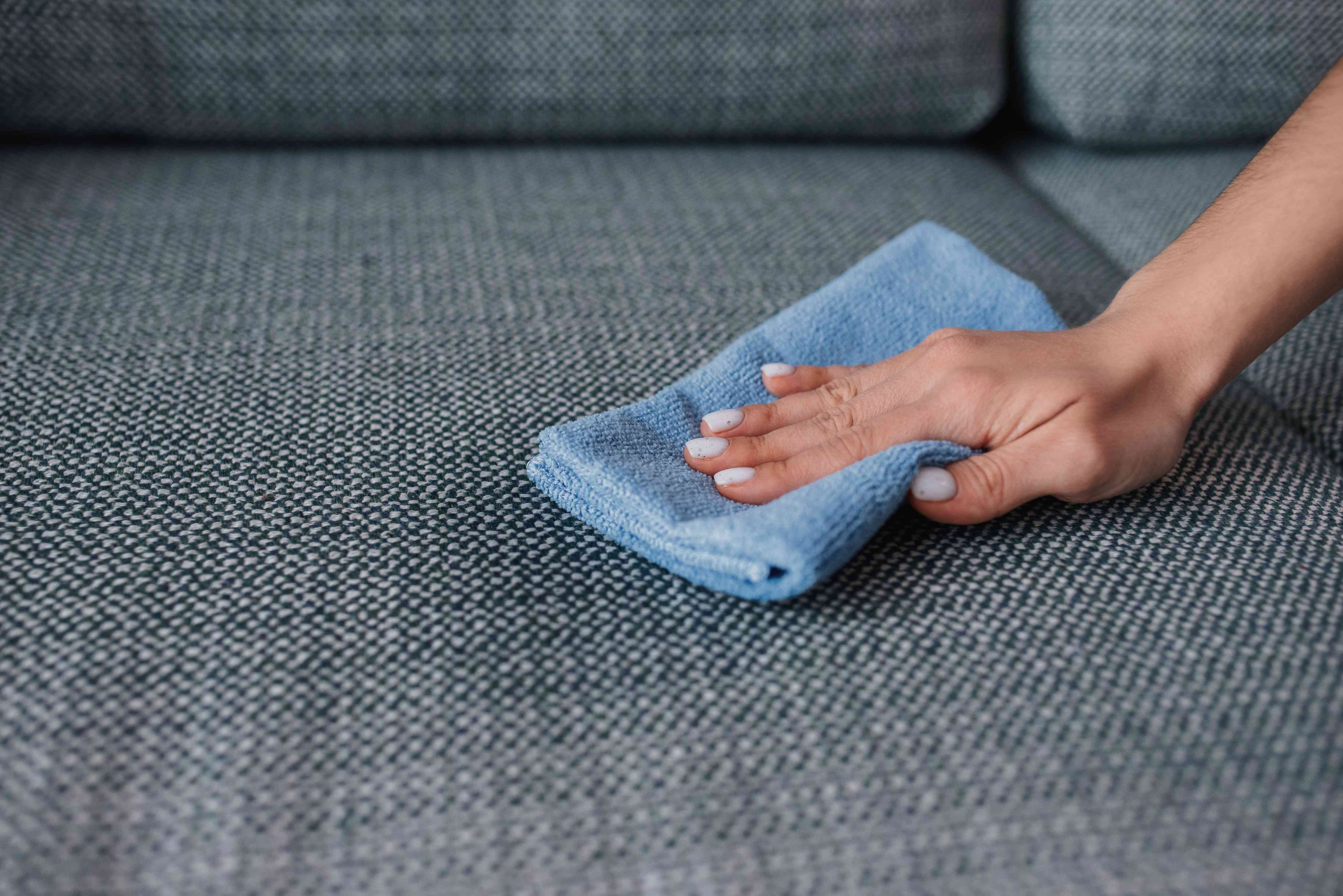 blotting a stain on a sofa